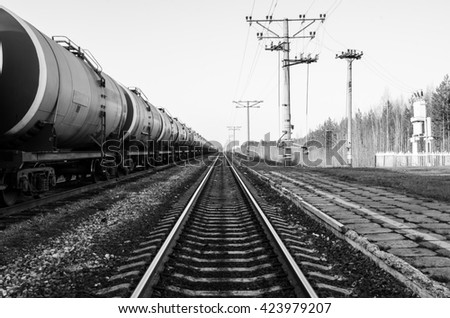 Train with oil tanks. Transportation of fuel on the railroad. Black and white shot. - stock photo