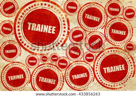 trainee, red stamp on a grunge paper texture - stock photo