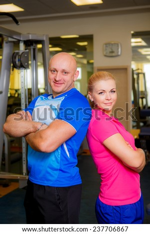 trainer at the gym - stock photo