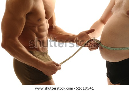 Trainer measures overweight man - stock photo