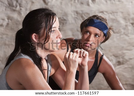 Trainer watching over young athlete working out - stock photo