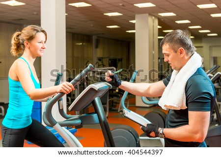Trainer writes the result to the athletes training in the gym - stock photo