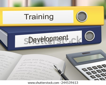 training and development binders isolated on the office table - stock photo
