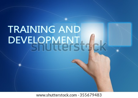 Training and Development - hand pressing button on interface with blue background. - stock photo