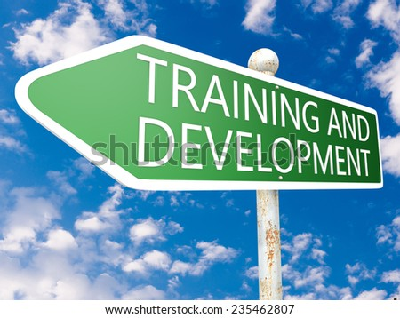 Training and Development - street sign illustration in front of blue sky with clouds. - stock photo