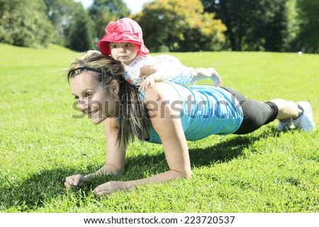 Training baby on grass - stock photo