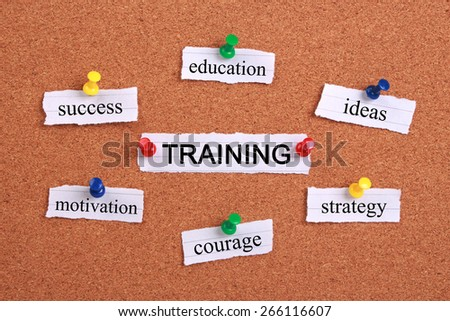 Training concept paper words are pinned on cork. - stock photo