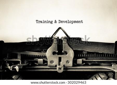 Training & Development message typed on a Vintage Typewriter.  - stock photo