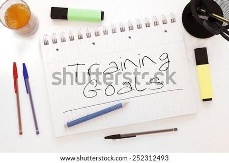 Training Goals - handwritten text in a notebook on a desk - 3d render illustration. - stock photo