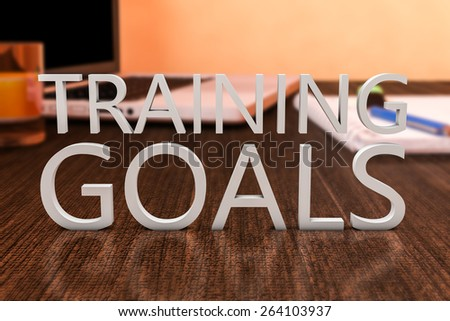 Training Goals - letters on wooden desk with laptop computer and a notebook. 3d render illustration. - stock photo