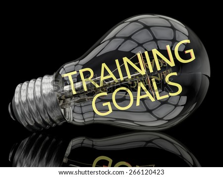 Training Goals - lightbulb on black background with text in it. 3d render illustration. - stock photo