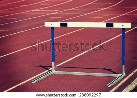 Training hurdles with an instagram and vintage effect. - stock photo