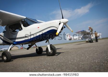 Training plane on runway - stock photo