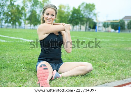 training stretching woman grass - stock photo