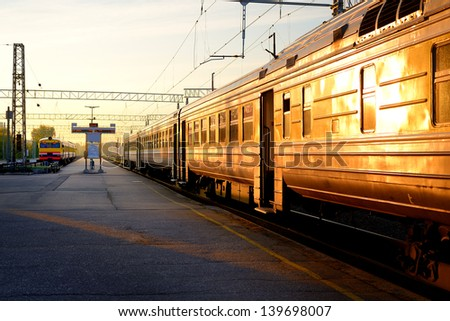 Trains at the station at the sunrise - stock photo