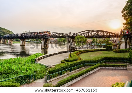 Trains for travel running on the old bridge over the River Kwai Yai at sunset is a historical attractions during World War 2 the famous of Kanchanaburi Province in Thailand - stock photo