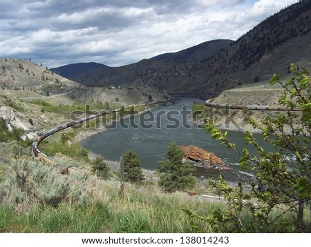 Trains on both sides of the river - stock photo