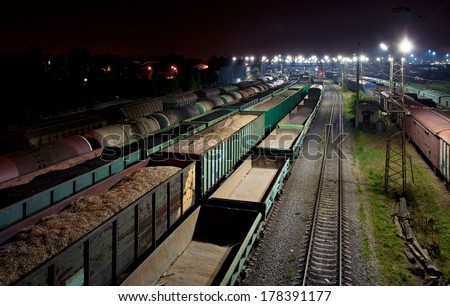 Trains shipping coal, grain, sawdust (splint) and fuel oil - stock photo