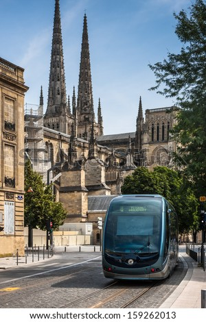 Tram near Cathedral of St. Andre in Bordeaux, France - stock photo