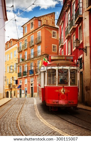 tram on narrow street of Alfama, Lisbon, Portugal, retro toned - stock photo