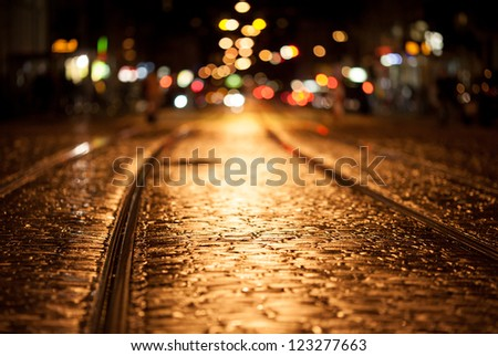 tram rails at night in freiburg - stock photo