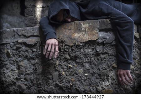 Tramp lying on the street. - stock photo