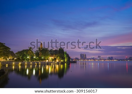 Tran Quoc pagoda in the afternoon in Hanoi, Vietnam. This pagoda locates on a small island near the southeastern shore of West Lake. This is the oldest Buddhist temple and tourist destination in Hanoi - stock photo