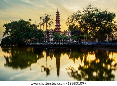 Tran Quoc pagoda in the sunset in Hanoi, Vietnam - stock photo