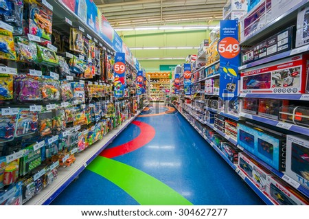 Trang, 25 June 2014: Rows of shelves with toys in Tesko Lotus mall at Trang, Trang province, Thailand. - stock photo