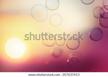 Tranquil background with soap bubbles floating in the sunset. Image toned in vintage instagram colors. Selective focus. - stock photo