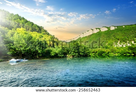 Tranquil backwater in mountains in sunny morning - stock photo