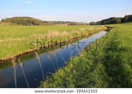 tranquil brook through bog land valley, natural bavarian site - stock photo