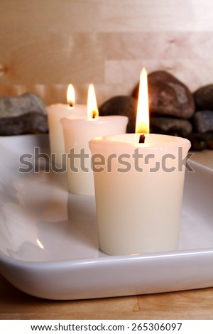 Tranquil candles and pebbles - stock photo