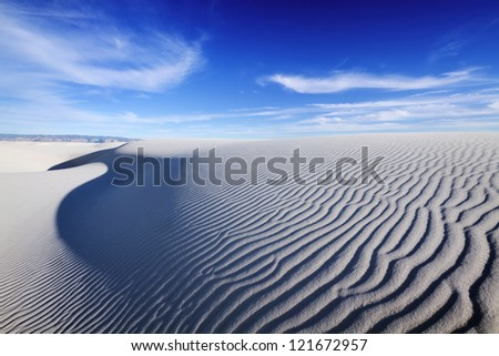 Tranquil image of sand dunes and beautiful blue sky, White Sands National Monument. - stock photo