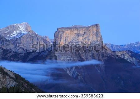 Tranquil sunrise at Mont Aiguille, in the French Vercors. - stock photo