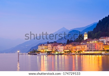 Tranquil sunset and evening illuminations of the beautiful town of Bellagio on Lake Como in Italy. - stock photo