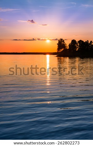 tranquil view of a beautiful sunset in Sweden one evening in July - stock photo