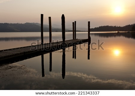 Tranquil warm sunrise over Chatcolet Lake in north Idaho. - stock photo