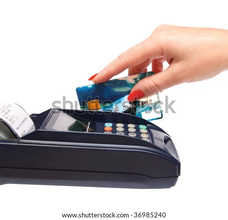 transaction - women hand with credit card in payment terminal - stock photo