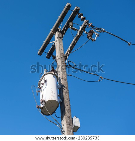 Transformer and power lines on electric pole - stock photo