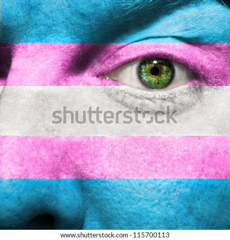 Transgender Flag painted on face  to show Transgender Pride support - stock photo