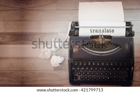 Translate message on a white background against typewriter with paper on table in office - stock photo