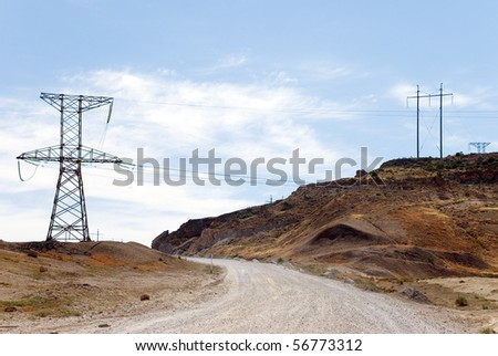 Transmission line in semi-desert - stock photo