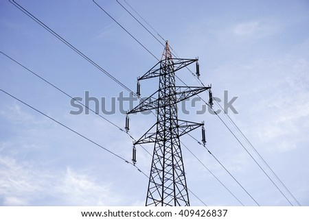 Transmission Tower (Electricity Pylon) with blue sky and clouds. - stock photo