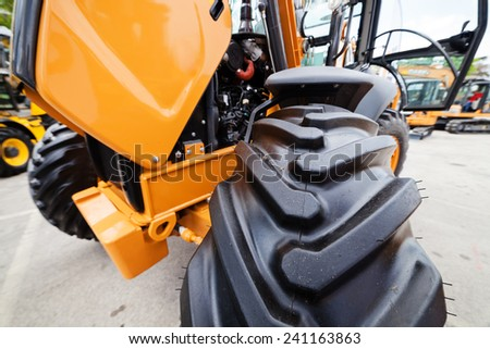 Transmission unit of tractor's front wheel with tire - stock photo