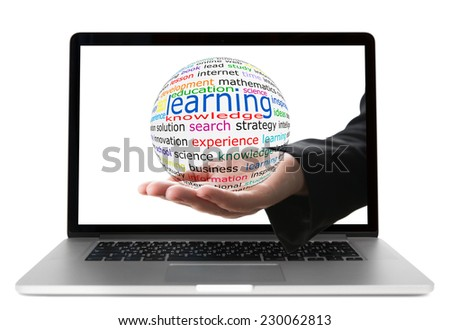 Transparent ball with inscription learning in a hand from display of laptop - stock photo