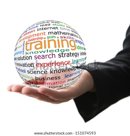 Transparent ball with inscription training in a hand - stock photo