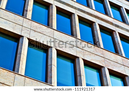 Transparent blue building windows of business center - stock photo