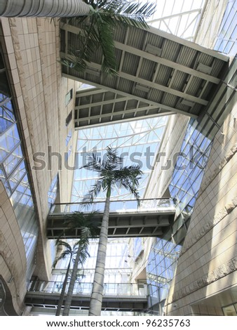 Transparent ceiling and elevated walkway - stock photo