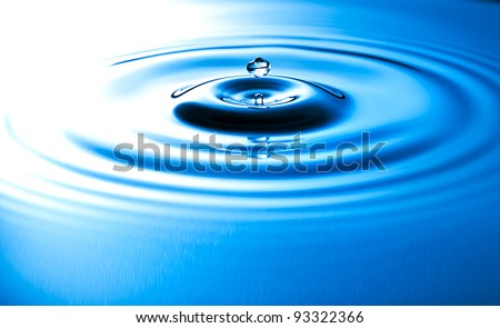 Transparent drop of water, falls downwards. - stock photo